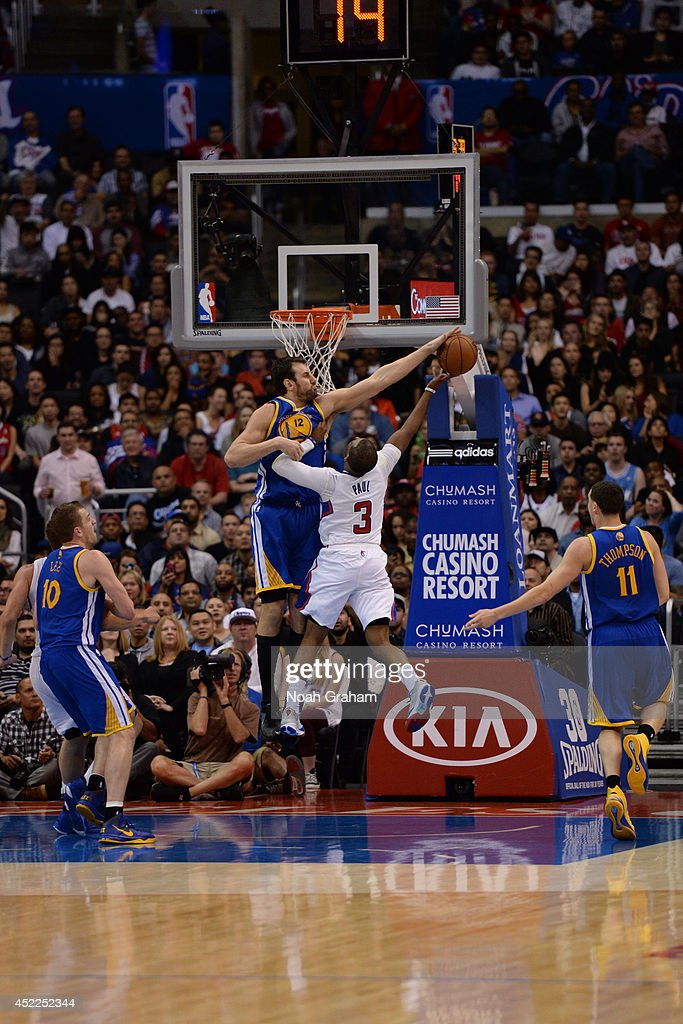 <a gi-track='captionPersonalityLinkClicked' href=/galleries/search?phrase=Andrew+Bogut&family=editorial&specificpeople=207105 ng-click='$event.stopPropagation()'>Andrew Bogut</a> #12 of the Golden State Warriors blocks a shot against <a gi-track='captionPersonalityLinkClicked' href=/galleries/search?phrase=Chris+Paul&family=editorial&specificpeople=212762 ng-click='$event.stopPropagation()'>Chris Paul</a> #3 of the Los Angeles Clippers at STAPLES Center on March 12, 2014 in Los Angeles, California.