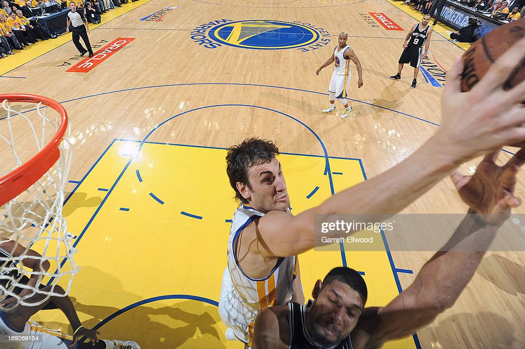 <a gi-track='captionPersonalityLinkClicked' href=/galleries/search?phrase=Andrew+Bogut&family=editorial&specificpeople=207105 ng-click='$event.stopPropagation()'>Andrew Bogut</a> #12 of the Golden State Warriors blocks a shot against <a gi-track='captionPersonalityLinkClicked' href=/galleries/search?phrase=Tim+Duncan&family=editorial&specificpeople=201467 ng-click='$event.stopPropagation()'>Tim Duncan</a> #21 of the San Antonio Spurs in Game Three of the Western Conference Semifinals during the 2013 NBA Playoffs on May 10, 2013 at the Oracle Arena in Oakland, California.
