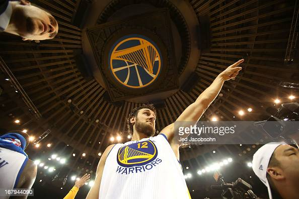 Andrew Bogut of the Golden State Warriors celebrates after defeating the Denver Nuggets during Game Six of the Western Conference Quarterfinals of...
