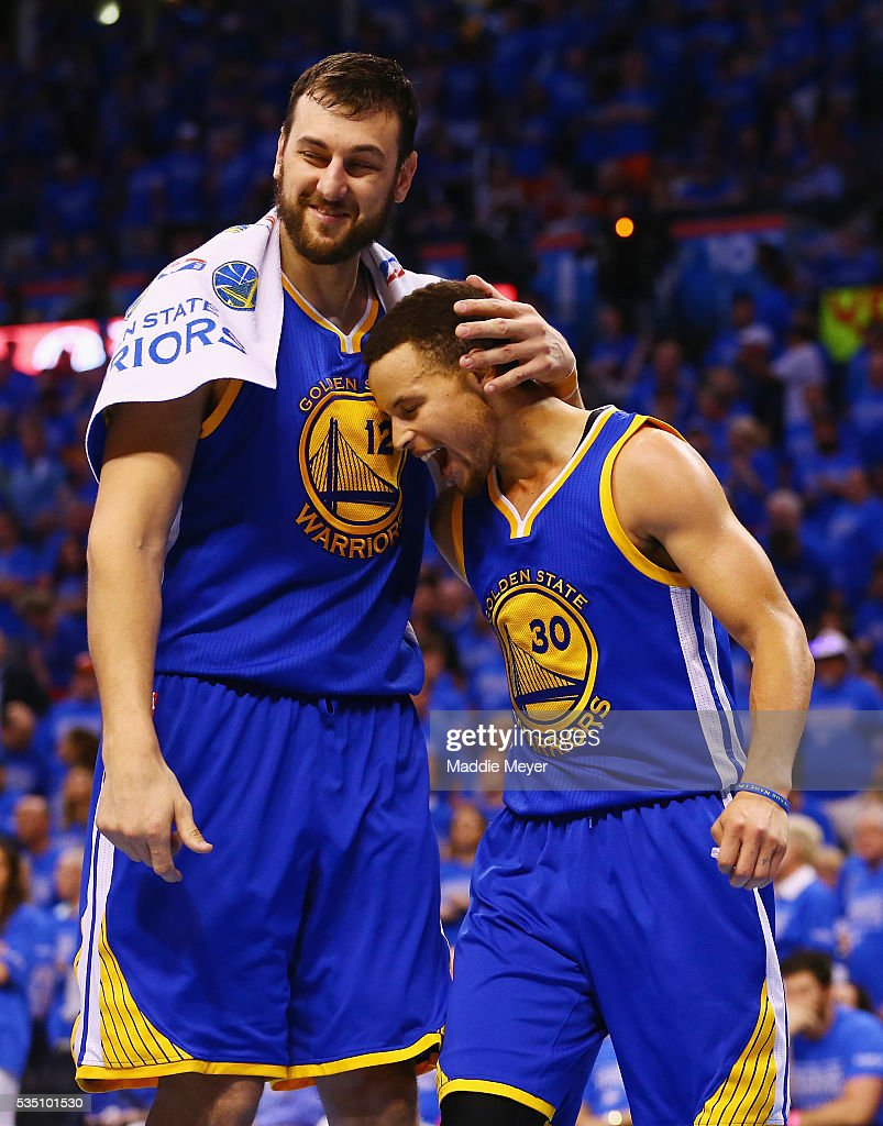 Andrew Bogut #12 of the Golden State Warriors celebrates with Stephen Curry #30 during the second half against the Oklahoma City Thunder in game six of the Western Conference Finals during the 2016 NBA Playoffs at Chesapeake Energy Arena on May 28, 2016 in Oklahoma City, Oklahoma.