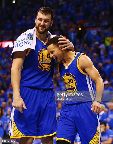 Andrew Bogut of the Golden State Warriors celebrates with Stephen Curry during the second half against the Oklahoma City Thunder in game six of the...