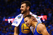 Andrew Bogut of the Golden State Warriors celebrates with Stephen Curry during the fourth quarter against the Oklahoma City Thunder in game six of...
