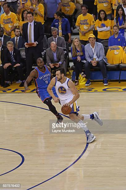 Andrew Bogut of the Golden State Warriors drives to the basket against the Oklahoma City Thunder in Game Five of the Western Conference Finals during...