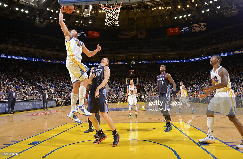 <a gi-track='captionPersonalityLinkClicked' href=/galleries/search?phrase=Andrew+Bogut&family=editorial&specificpeople=207105 ng-click='$event.stopPropagation()'>Andrew Bogut</a> #12 of the Golden State Warriors dunks against <a gi-track='captionPersonalityLinkClicked' href=/galleries/search?phrase=Cody+Zeller&family=editorial&specificpeople=7621233 ng-click='$event.stopPropagation()'>Cody Zeller</a> #40 of the Charlotte Bobcats on February 4, 2014 at Oracle Arena in Oakland, California.
