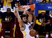 Andrew Bogut of the Golden State Warriors dunks against the Cleveland Cavaliers in the fourth quarter during Game One of the 2015 NBA Finals at...