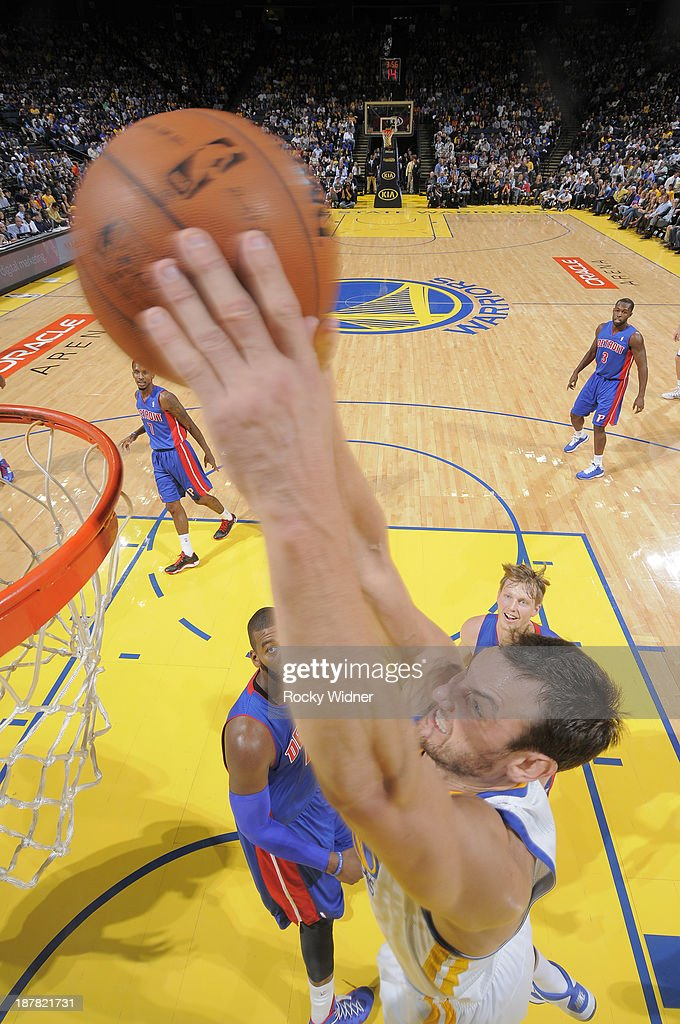 Andrew Bogut #12 of the Golden State Warriors dunks against the Detroit Pistons on November 12, 2013 at Oracle Arena in Oakland, California.