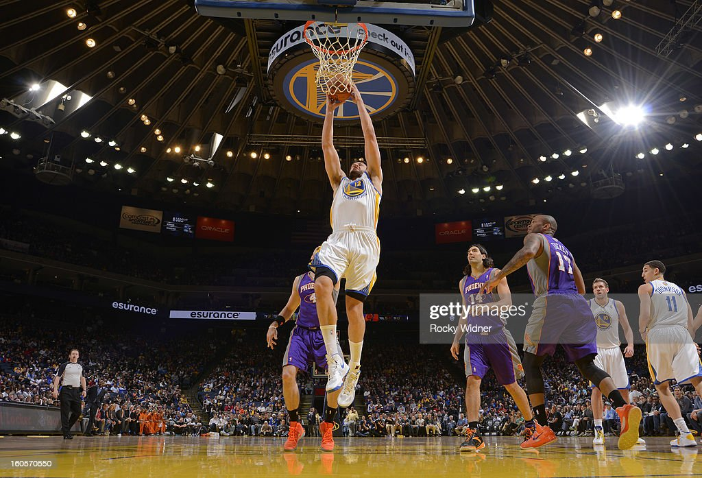 Andrew Bogut #12 of the Golden State Warriors dunks against the Phoenix Suns on February 2, 2013 at Oracle Arena in Oakland, California.