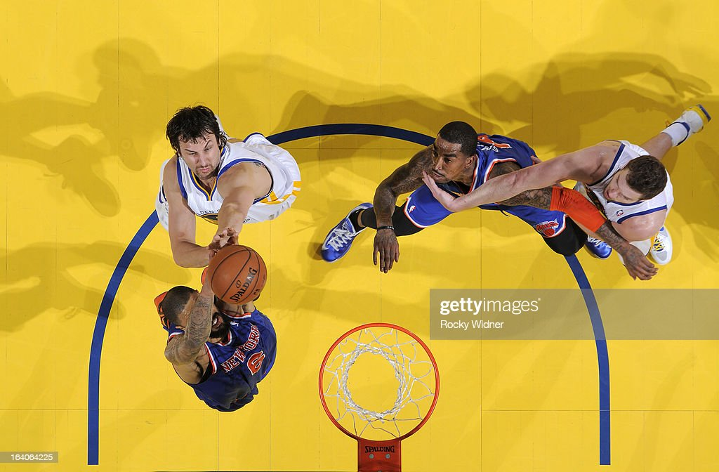 <a gi-track='captionPersonalityLinkClicked' href=/galleries/search?phrase=Andrew+Bogut&family=editorial&specificpeople=207105 ng-click='$event.stopPropagation()'>Andrew Bogut</a> #12 of the Golden State Warriors fights for the rebound against the New York Knicks on March 11, 2013 at Oracle Arena in Oakland, California.