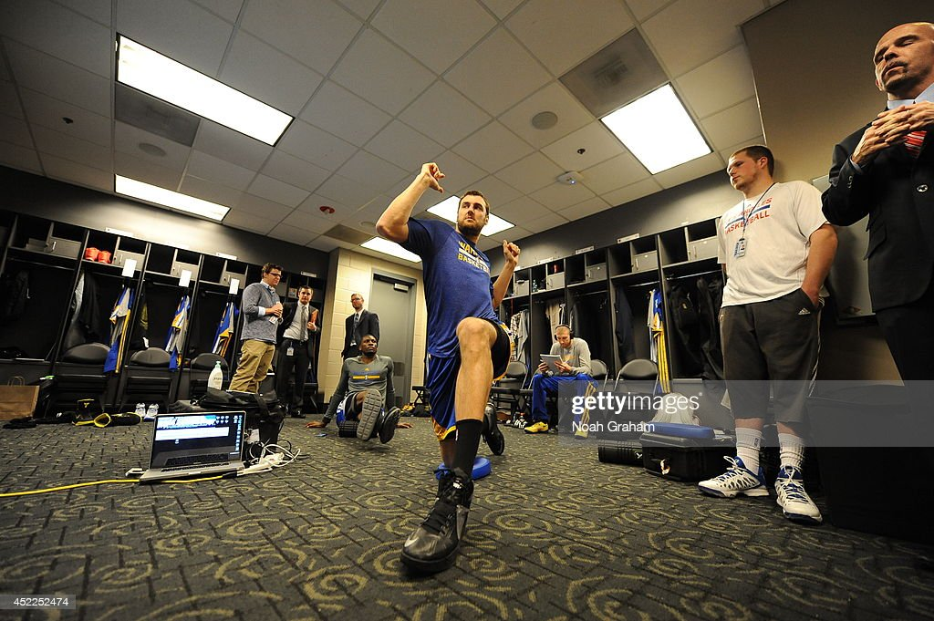 <a gi-track='captionPersonalityLinkClicked' href=/galleries/search?phrase=Andrew+Bogut&family=editorial&specificpeople=207105 ng-click='$event.stopPropagation()'>Andrew Bogut</a> #12 of the Golden State Warriors gets ready in the locker room before the game against the Los Angeles Clippers at STAPLES Center on March 12, 2014 in Los Angeles, California.