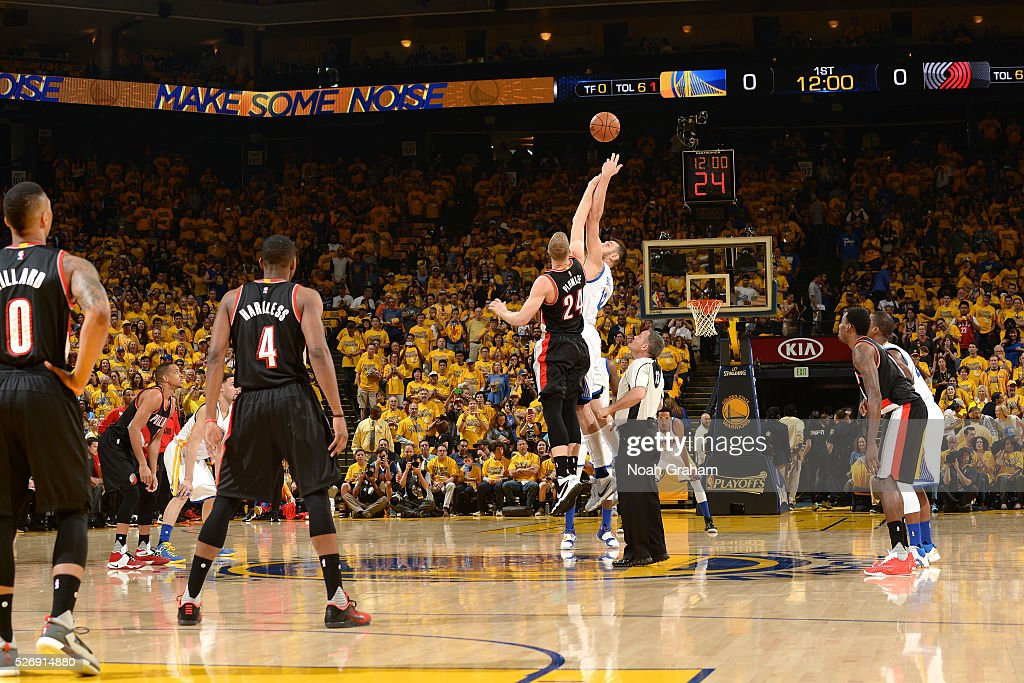 Andrew Bogut #12 of the Golden State Warriors goes for the jump ball against Mason Plumlee #24 of the Portland Trail Blazers during the game in Game One of the Western Conference Semifinals during the 2016 NBA Playoffs on May 1, 2016 at ORACLE Arena in Oakland, California.