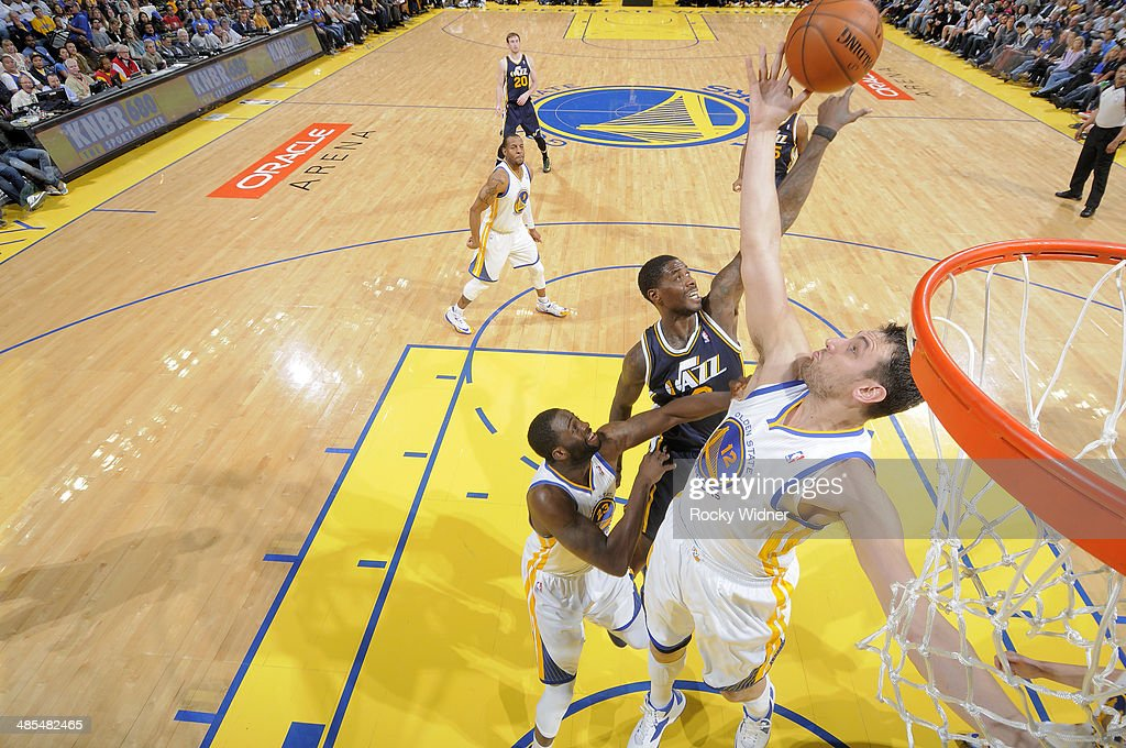 <a gi-track='captionPersonalityLinkClicked' href=/galleries/search?phrase=Andrew+Bogut&family=editorial&specificpeople=207105 ng-click='$event.stopPropagation()'>Andrew Bogut</a> #12 of the Golden State Warriors goes for the rebound against the Utah Jazz on April 6, 2014 at Oracle Arena in Oakland, California.