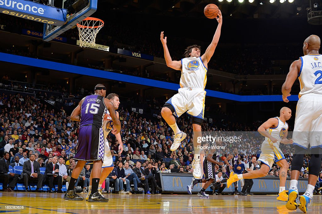 Andrew Bogut #12 of the Golden State Warriors grabs a rebound against the Sacramento Kings on March 6, 2013 at Oracle Arena in Oakland, California.