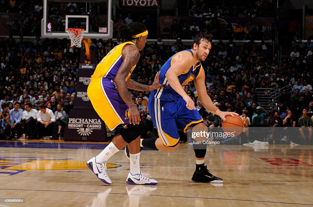 Andrew Bogut #12 of the Golden State Warriors handles the basketball during a game against the Los Angeles Lakers on October 9, 2014 at the Staples Center in Los Angeles, California.