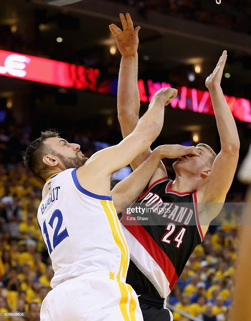 Andrew Bogut #12 of the Golden State Warriors puts his hand on the face of Mason Plumlee #24 of the Portland Trail Blazers as they go for a rebound during Game One of the Western Conference Semifinals for the 2016 NBA Playoffs at ORACLE Arena on May 01, 2016 in Oakland, California.