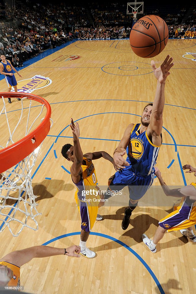 <a gi-track='captionPersonalityLinkClicked' href=/galleries/search?phrase=Andrew+Bogut&family=editorial&specificpeople=207105 ng-click='$event.stopPropagation()'>Andrew Bogut</a> #12 of the Golden State Warriors puts up the shot against Nick Young #0 of the Los Angeles Lakers at Citizens Business Bank Arena on October 5, 2013 in Ontario, California.