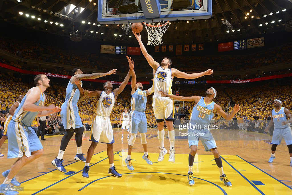 Andrew Bogut #12 of the Golden State Warriors rebounds against Corey Brewer #13 of the Denver Nuggets in Game Six of the Western Conference Quarterfinals during the 2013 NBA Playoffs on May 2, 2013 at Oracle Arena in Oakland, California.