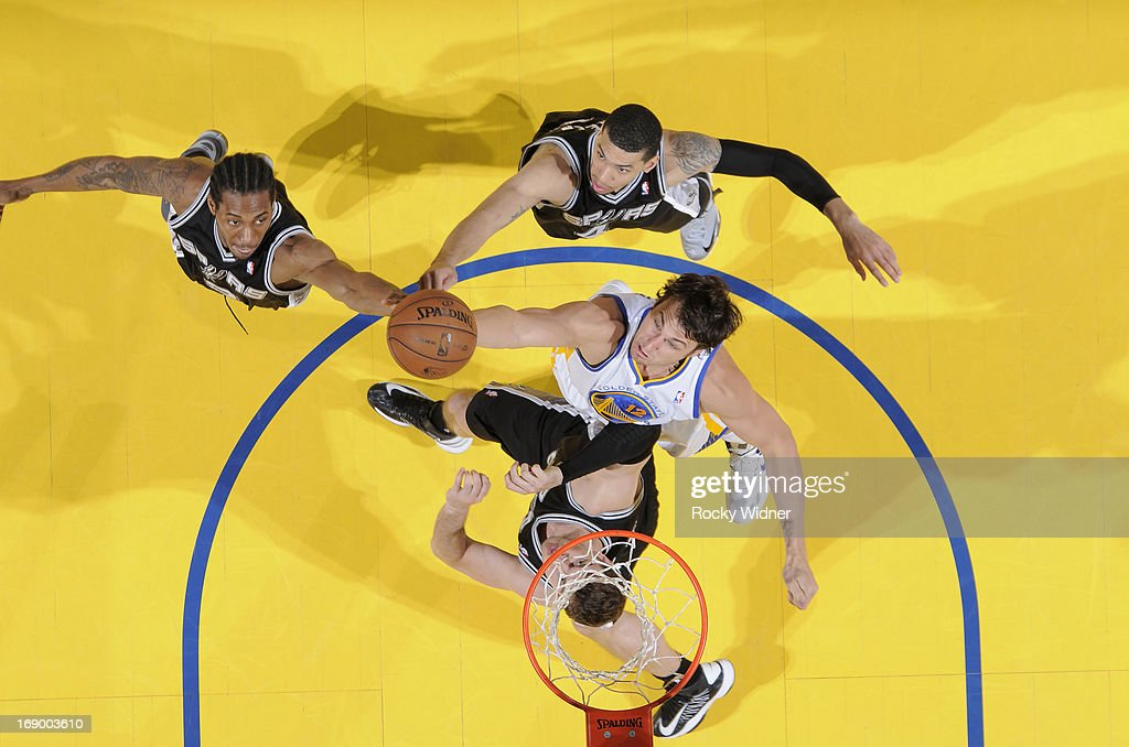 <a gi-track='captionPersonalityLinkClicked' href=/galleries/search?phrase=Andrew+Bogut&family=editorial&specificpeople=207105 ng-click='$event.stopPropagation()'>Andrew Bogut</a> #12 of the Golden State Warriors rebounds against <a gi-track='captionPersonalityLinkClicked' href=/galleries/search?phrase=Kawhi+Leonard&family=editorial&specificpeople=6691012 ng-click='$event.stopPropagation()'>Kawhi Leonard</a> #2, Danny Green #4 and <a gi-track='captionPersonalityLinkClicked' href=/galleries/search?phrase=Tiago+Splitter&family=editorial&specificpeople=208218 ng-click='$event.stopPropagation()'>Tiago Splitter</a> #22 of the San Antonio Spurs in Game Four of the Western Conference Semifinals during the 2013 NBA Playoffs on May 12, 2013 at Oracle Arena in Oakland, California.