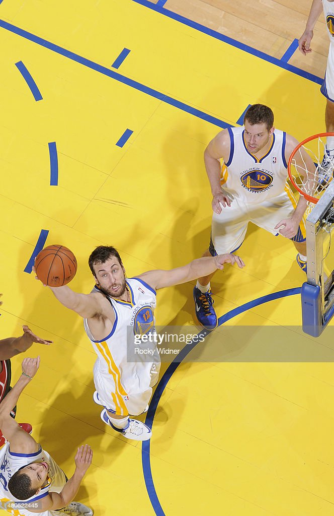 <a gi-track='captionPersonalityLinkClicked' href=/galleries/search?phrase=Andrew+Bogut&family=editorial&specificpeople=207105 ng-click='$event.stopPropagation()'>Andrew Bogut</a> #12 of the Golden State Warriors rebounds against the Milwaukee Bucks on March 20, 2014 at Oracle Arena in Oakland, California.