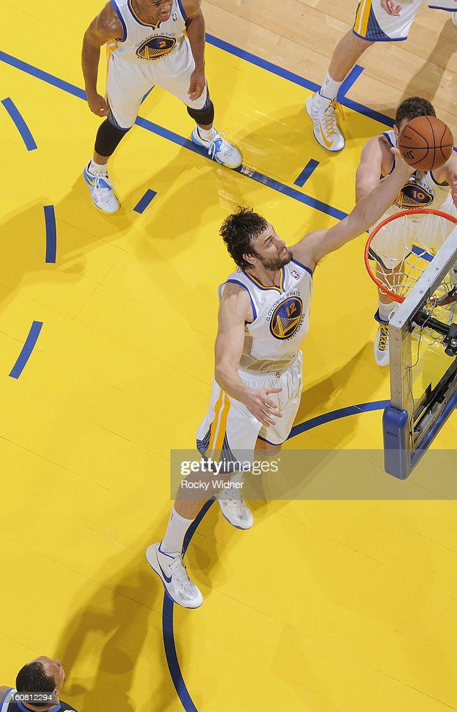 <a gi-track='captionPersonalityLinkClicked' href=/galleries/search?phrase=Andrew+Bogut&family=editorial&specificpeople=207105 ng-click='$event.stopPropagation()'>Andrew Bogut</a> #12 of the Golden State Warriors rebounds against the Dallas Mavericks on January 31, 2013 at Oracle Arena in Oakland, California.