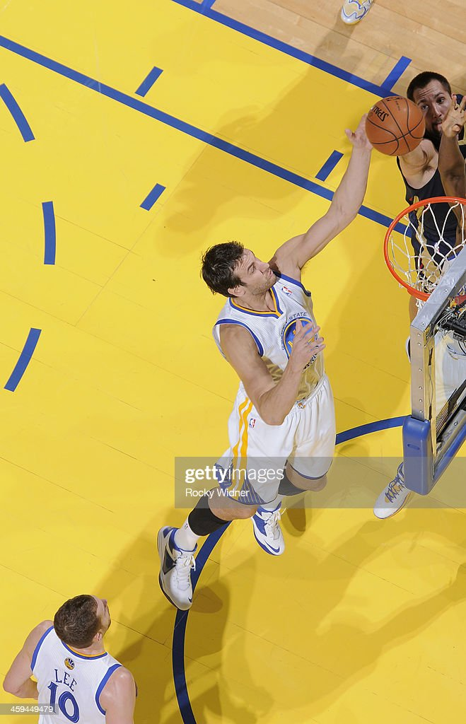 <a gi-track='captionPersonalityLinkClicked' href=/galleries/search?phrase=Andrew+Bogut&family=editorial&specificpeople=207105 ng-click='$event.stopPropagation()'>Andrew Bogut</a> #12 of the Golden State Warriors rebounds against the New Orleans Pelicans on December 17, 2013 at Oracle Arena in Oakland, California.
