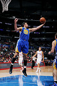 Andrew Bogut of the Golden State Warriors rebounds the basketball during a game against the Los Angeles Clippers on October 7 2014 at the Staples...