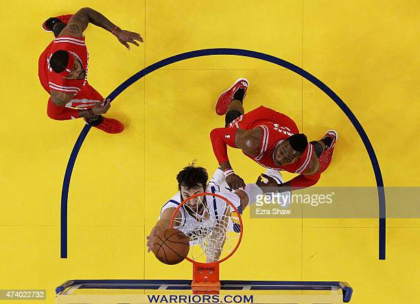 Andrew Bogut of the Golden State Warriors shoots against Dwight Howard and Josh Smith of the Houston Rockets in the first half during Game One of the...