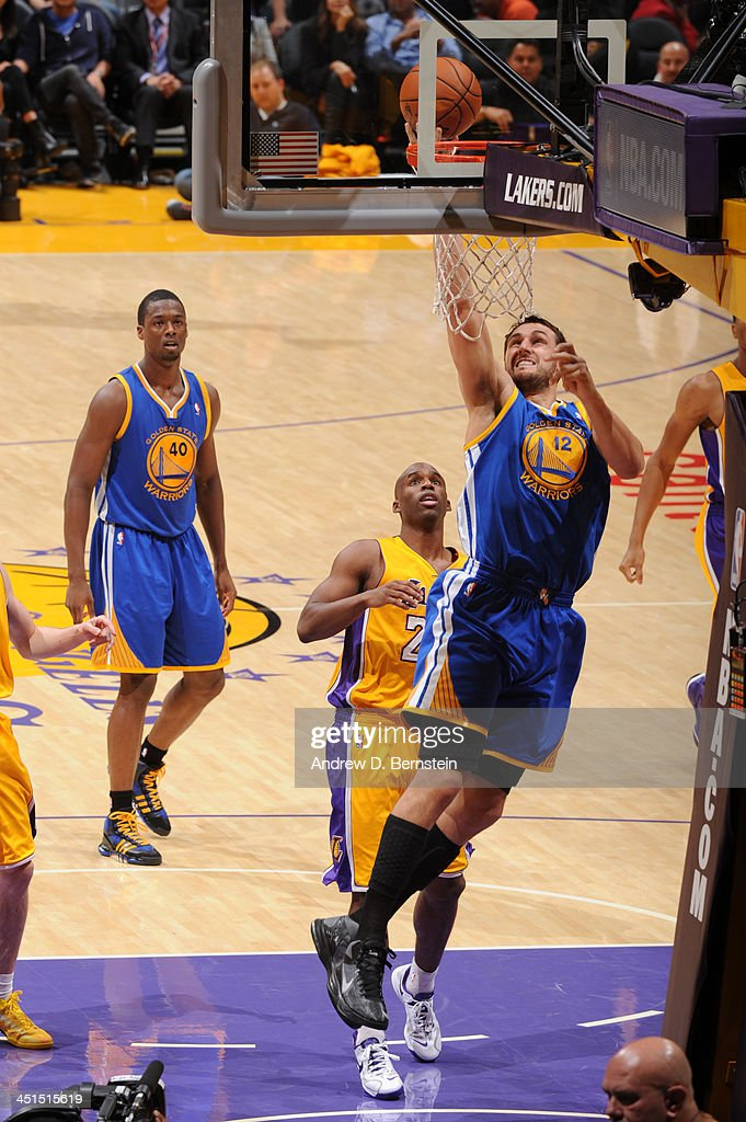 <a gi-track='captionPersonalityLinkClicked' href=/galleries/search?phrase=Andrew+Bogut&family=editorial&specificpeople=207105 ng-click='$event.stopPropagation()'>Andrew Bogut</a> #12 of the Golden State Warriors shoots during a game against the Los Angeles Lakers on November 22, 2013 at STAPLES Center in Los Angeles, California.