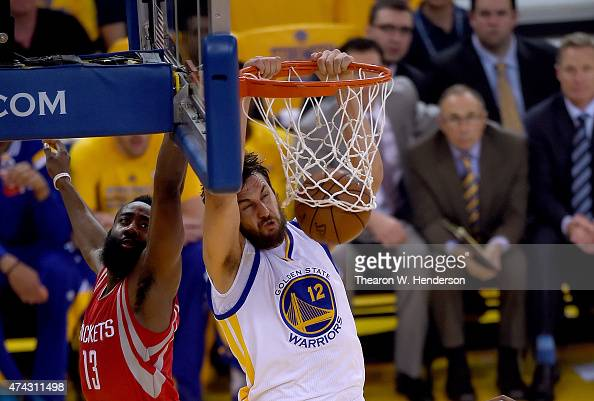 Andrew Bogut of the Golden State Warriors slam dunks against James Harden of the Houston Rockets during the first half in Game Two of the Western...