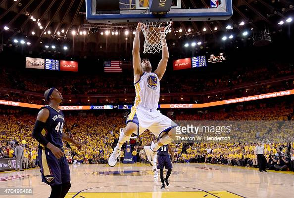 Andrew Bogut of the Golden State Warriors slam dunks the ball against the New Orleans Pelicans in the fourth quarter during the first round of the...