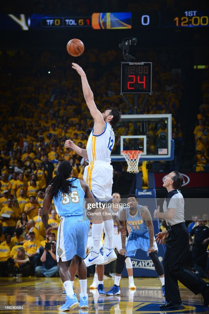 Andrew Bogut #12 of the Golden State Warriors wins a jump ball against Kenneth Faried #35 of the Denver Nuggets in Game Four of the Western Conference Quarterfinals during the 2013 NBA Playoffs on April 28, 2013 at the Oracle Arena in Oakland, California.