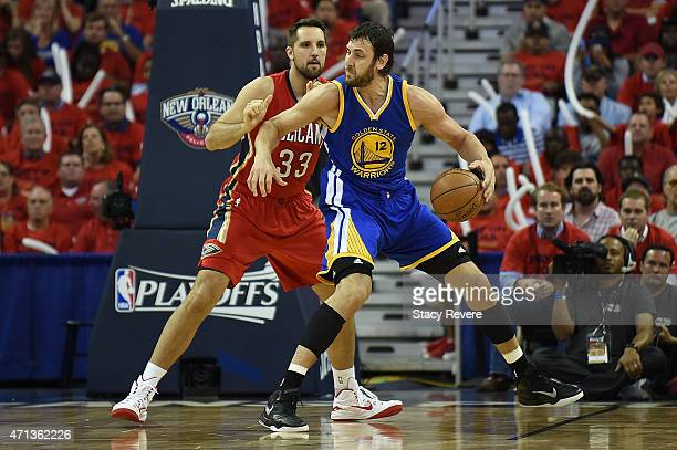 Andrew Bogut of the Golden State Warriors works against Ryan Anderson of the New Orleans Pelicans during Game Three in the first round of the 2015...