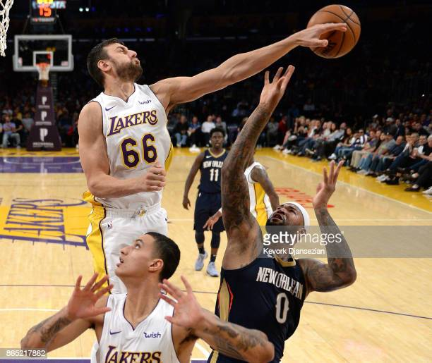 Andrew Bogut of the Los Angeles Lakers blocks a shot by DeMarcus Cousins of the New Orleans Pelicans as Kyle Kuzma of the Los Angeles Lakers looks on...