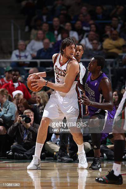 Andrew Bogut of the Milwakee Bucks moves the ball against the Sacramento Kings on on March 23 2011 at the Bradley Center in Milwaukee Wisconsin NOTE...