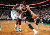 Andrew Bogut of the Milwaukee Bucks drives to the basket against Kendrick Perkins of the Boston Celtics on December 8 2009 at the TD Garden in Boston...