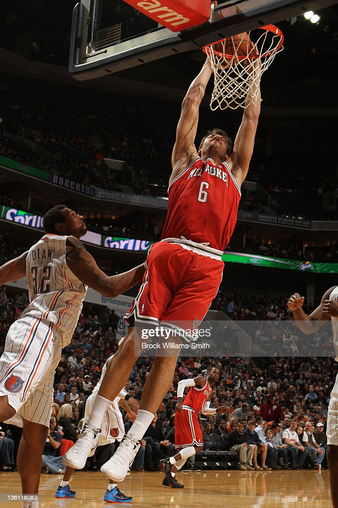 <a gi-track='captionPersonalityLinkClicked' href=/galleries/search?phrase=Andrew+Bogut&family=editorial&specificpeople=207105 ng-click='$event.stopPropagation()'>Andrew Bogut</a> #6 of the Milwaukee Bucks dunks against the Charlotte Bobcats on December 26, 2011 during the game at the Time Warner Cable Arena in Charlotte, North Carolina.