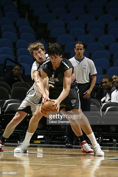 Andrew Bogut of the Milwaukee Bucks gets fouled by Nate Doornekamp of the Toronto Raptors during the 2005 Minnesota Summer League on July 17 2005 at...
