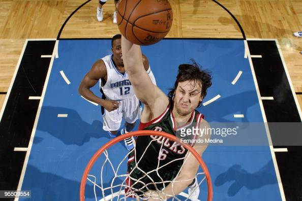 Andrew Bogut of the Milwaukee Bucks goes up to slam dunk against the Orlando Magic during the game on December 30 2009 at Amway Arena in Orlando...