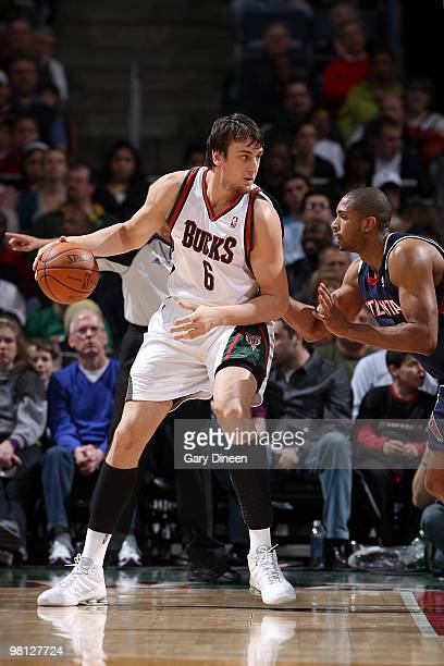 Andrew Bogut of the Milwaukee Bucks handles the ball against Al Horford of the Atlanta Hawks during the game on March 22 2010 at the Bradley Center...