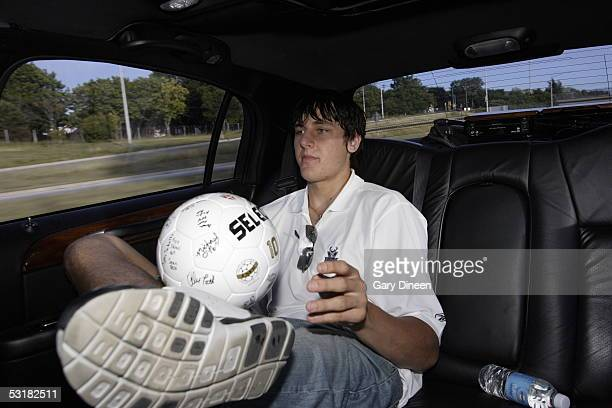 Andrew Bogut of the Milwaukee Bucks plays with an autographed soccer ball which he received as a gift from fans at Croatian Soccer Park on June 30...