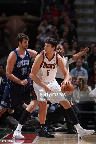 Andrew Bogut of the Milwaukee Bucks posts up against Mehmet Okur of the Utah Jazz on March 12 2010 at the Bradley Center in Milwaukee Wisconsin NOTE...