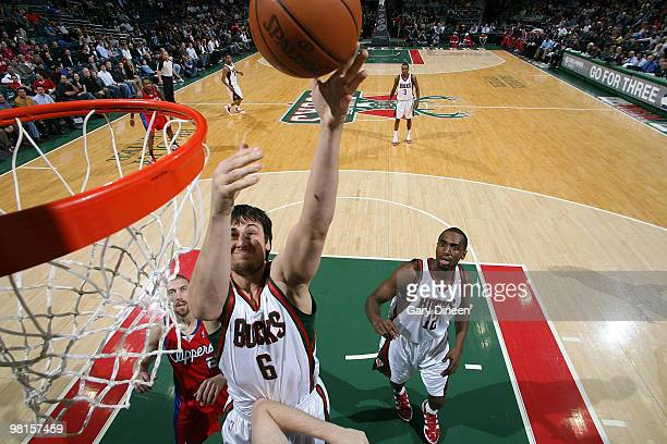 Andrew Bogut of the Milwaukee Bucks shoots a layup against Chris Kaman of the Los Angeles Clippers on March 30 2010 at the Bradley Center in...