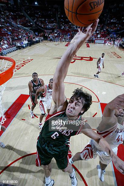 Andrew Bogut of the Milwaukee Bucks shoots the ball over Chuck Hayes of the Houston Rockets on October 12 2009 at the Toyota Center in Houston Texas...