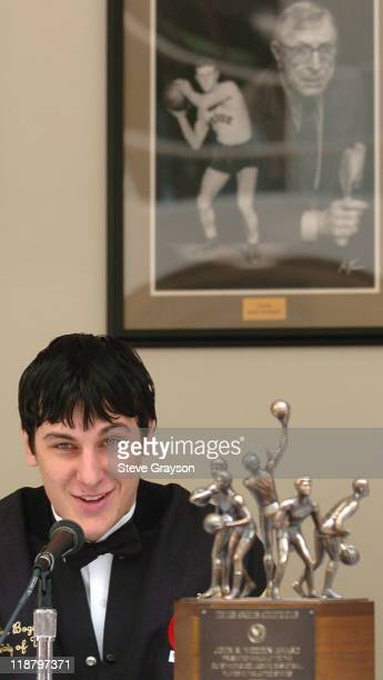 Andrew Bogut of Utahtalks to reporters next to his trophy as the winner of the 2005 John R Wooden award as the nation's best male college basketball...