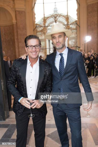 Andrew Boose and a guest arrive for the amfAR Paris Dinner at Le Petit Palais on July 2 2017 in Paris France