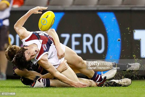 Andrew Brayshaw of the Dragons is tackled during the TAC Cup Grand Final match between the Murray Bushrangers and the Sandringham Dragons at Etihad...