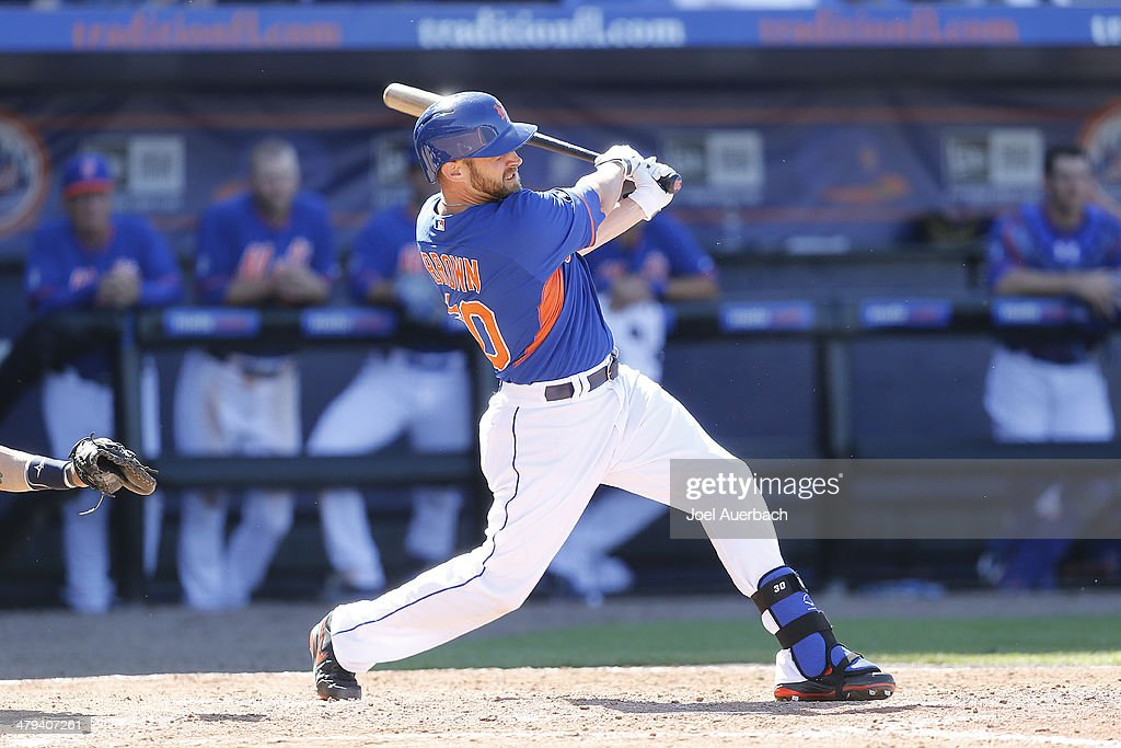 Andrew Brown #30 hits a single in the ninth inning scoring Anthony Seratelli #2 (not pictured) of the New York Mets as the winning run against the Detroit Tigers during a spring training game at Tradition Field on March 18, 2014 in Port St. Lucie, Florida. The Mets defeated the Tigers 5-4.