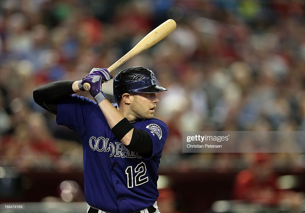 Andrew Brown #12 of the Colorado Rockies bats against the Arizona Diamondbacks during the MLB game at Chase Field on October 3, 2012 in Phoenix, Arizona.