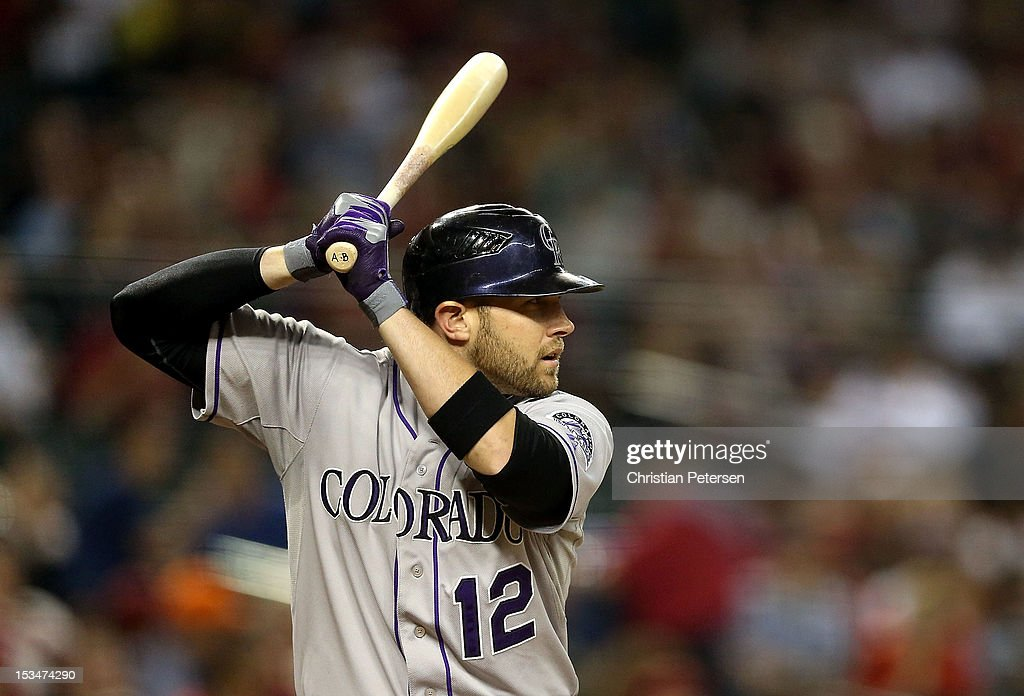 Andrew Brown #12 of the Colorado Rockies bats against the Arizona Diamondbacks during the MLB game at Chase Field on October 2, 2012 in Phoenix, Arizona. The Diamondbacks defeated the Rockies 5-3.