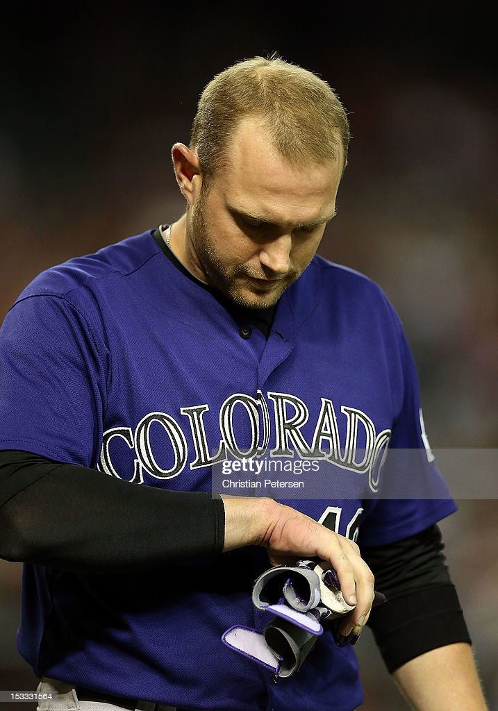 Andrew Brown #12 of the Colorado Rockies looks at his hand after striking out during the eighth inning of the MLB game against the Arizona Diamondbacks at Chase Field on October 3, 2012 in Phoenix, Arizona.