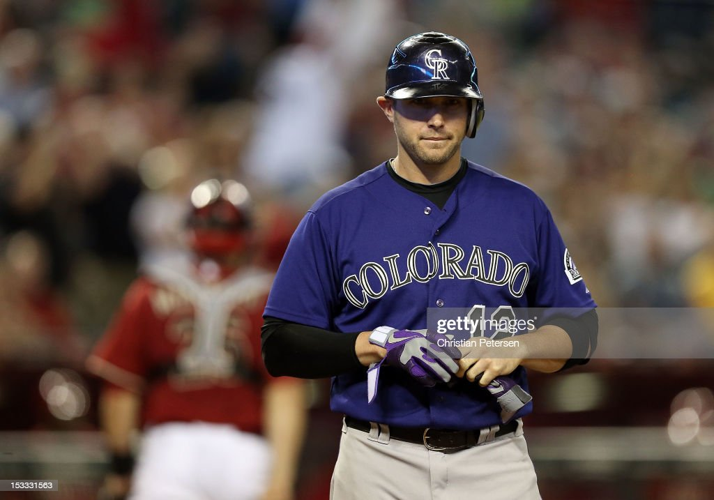 Andrew Brown #12 of the Colorado Rockies reacts after striking out during the eighth inning of the MLB game against the Arizona Diamondbacks at Chase Field on October 3, 2012 in Phoenix, Arizona.